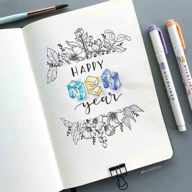 @bumblebujo made this stunning New Years layout My friend Kimmy is one of my favorite artists in the bullet journal community, and a quick peek at this spread explains why. She creates some of the best bullet journal flower drawings ever. I love the 3D feel of the font, as well.