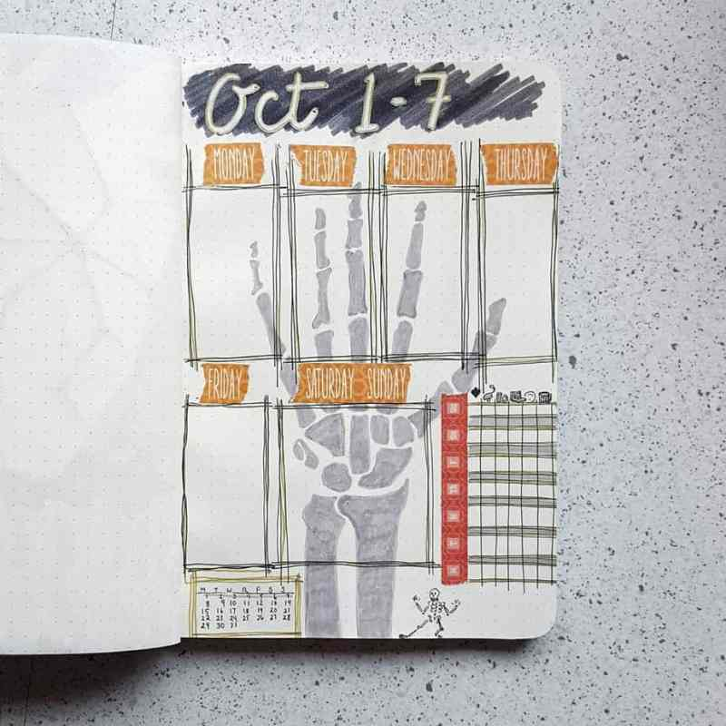 Bullet journal weekly spread with background skeleton hand and halloween coloring