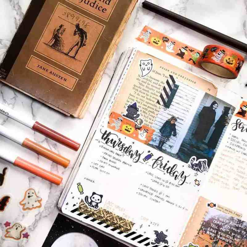 Bullet journal weekly spread with halloween washi, stickers, and colors