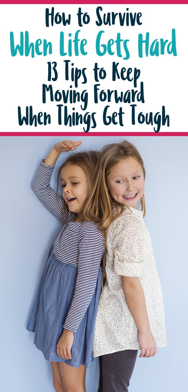 Pinterest image for 'When Life Gets Hard' blog post with two girls comparing heights.