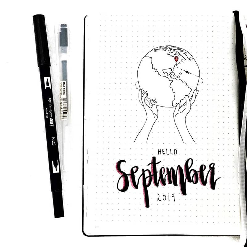 Hands holding the world bujo theme