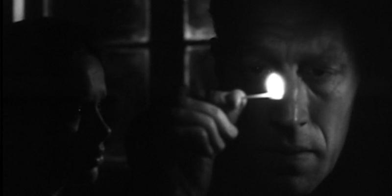 Liv Ullman e Max Von Sydow contracenam na escuridão.