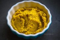 Golden beet spread in a dish.