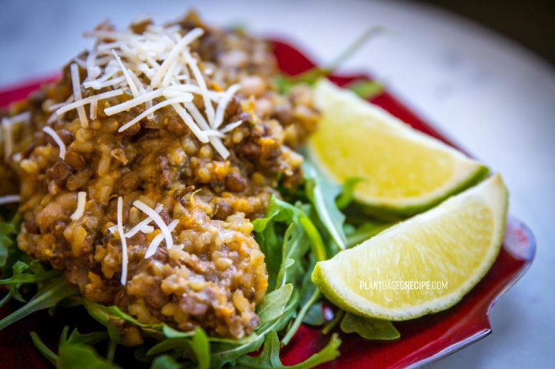 Garnish this bean and lentil dish with lime and vegan parmesan.