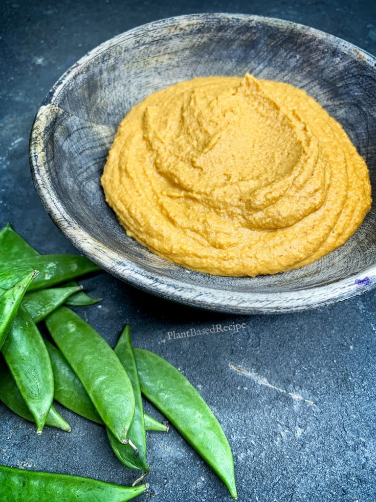 Creamy oil free vegan hummus spiced with curry.