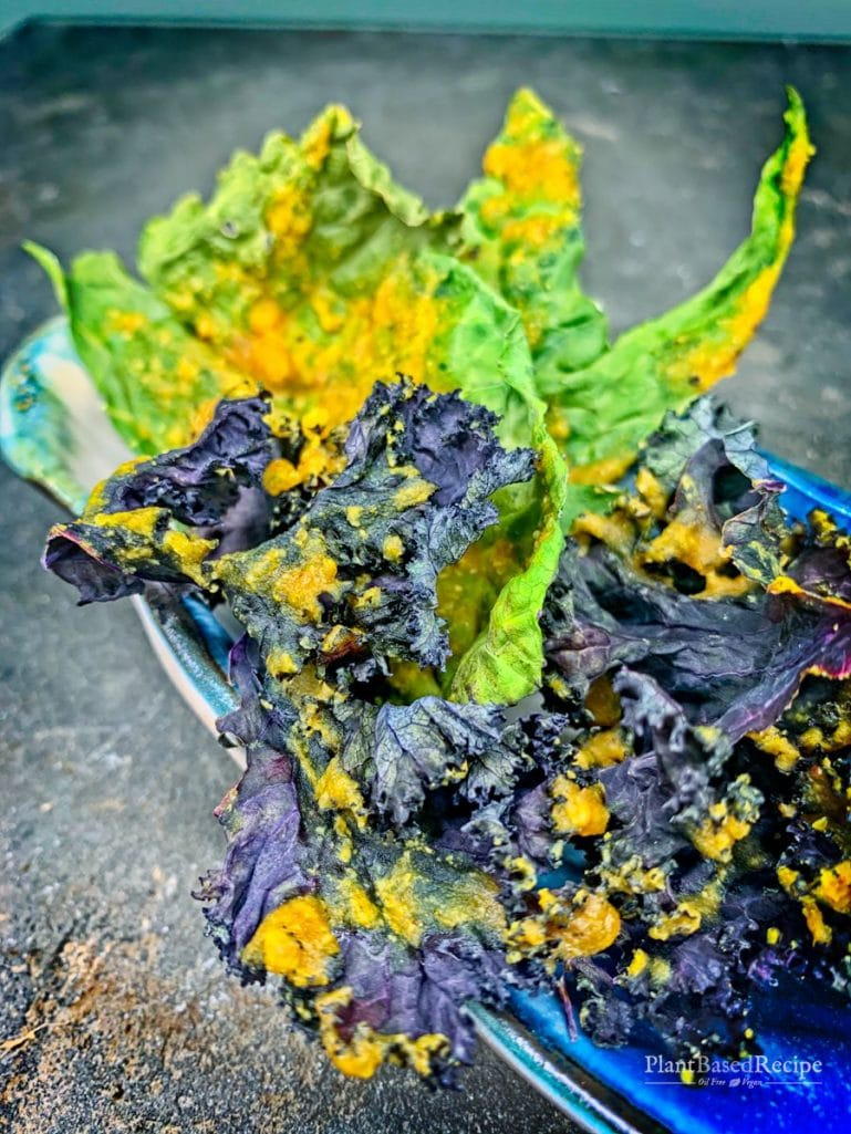 Baked kale chip recipe is vegan and oil free, featuring turmeric, lemon and nutritional yeast.