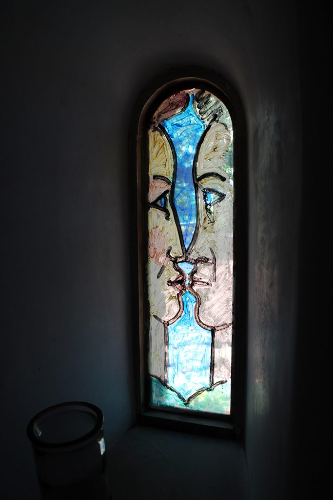 Inside the chapel, the hand painted stained glass windows give a rather lovely modern twist