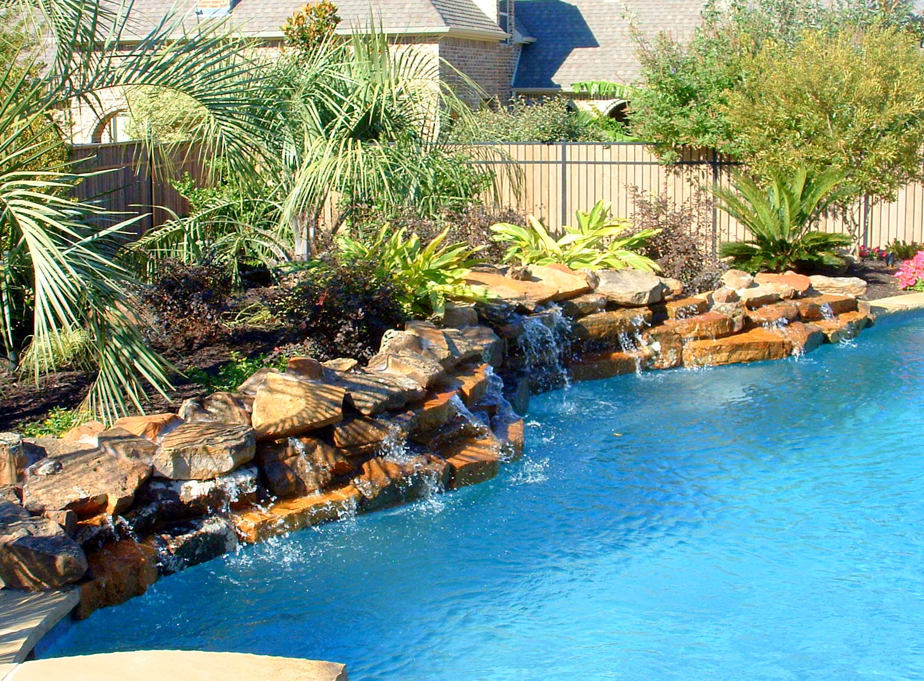 Our Water Feature Design Ideas | Miami | Plant Professionals on Rock Garden Waterfall Ideas  id=21974