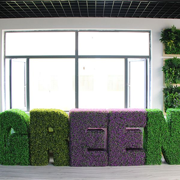 application of faux topiary letters GREEN