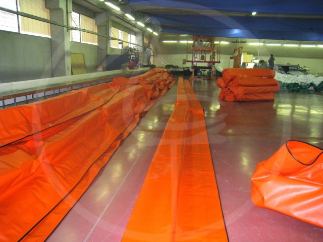 Rigid panel anti-pollution barriers working