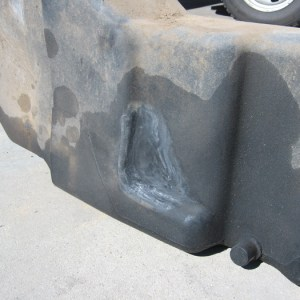 Tractor fuel tank with repaired hole