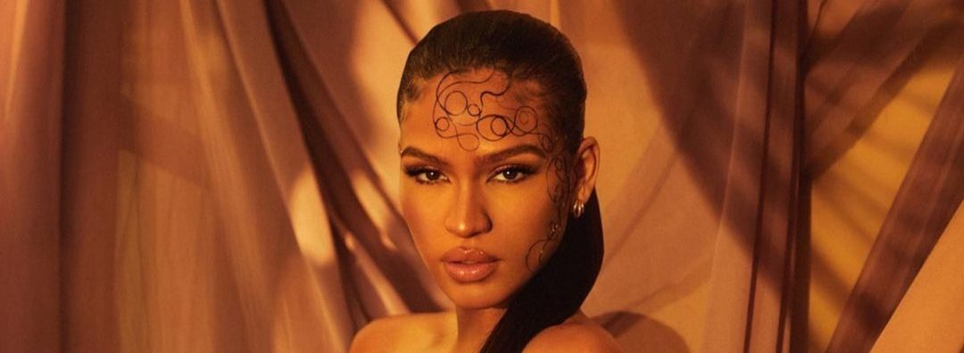 Cassie Is Pregnant And Fashionable In New Photos Showing Bare Baby Bump
