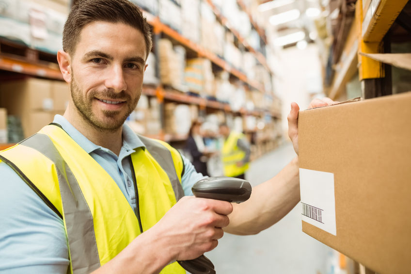 Man in warehouse scaning a boc with barcode scaning