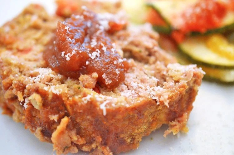 Slice of apple meatloaf topped with apple butter.
