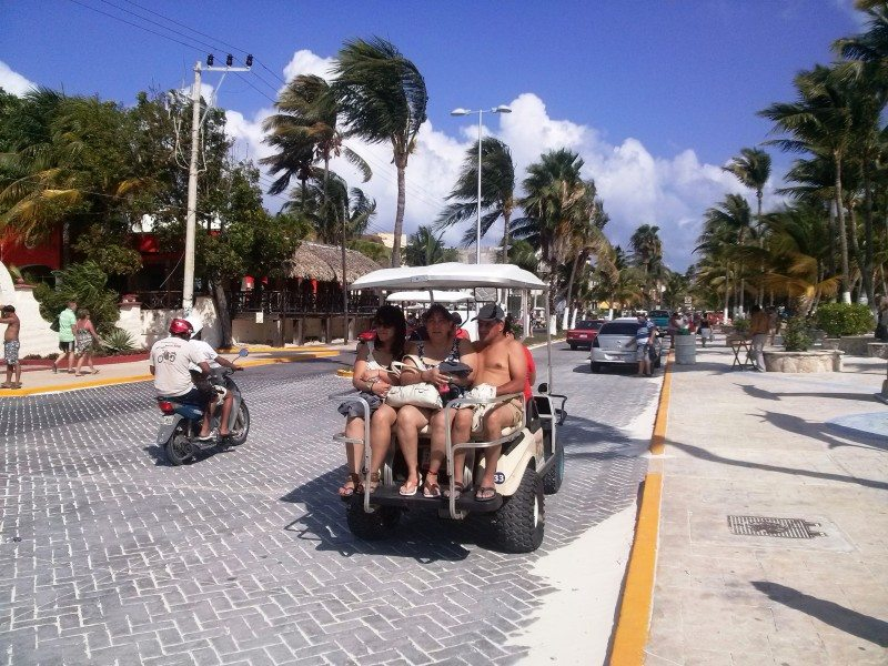 People on cart at isla mujeres