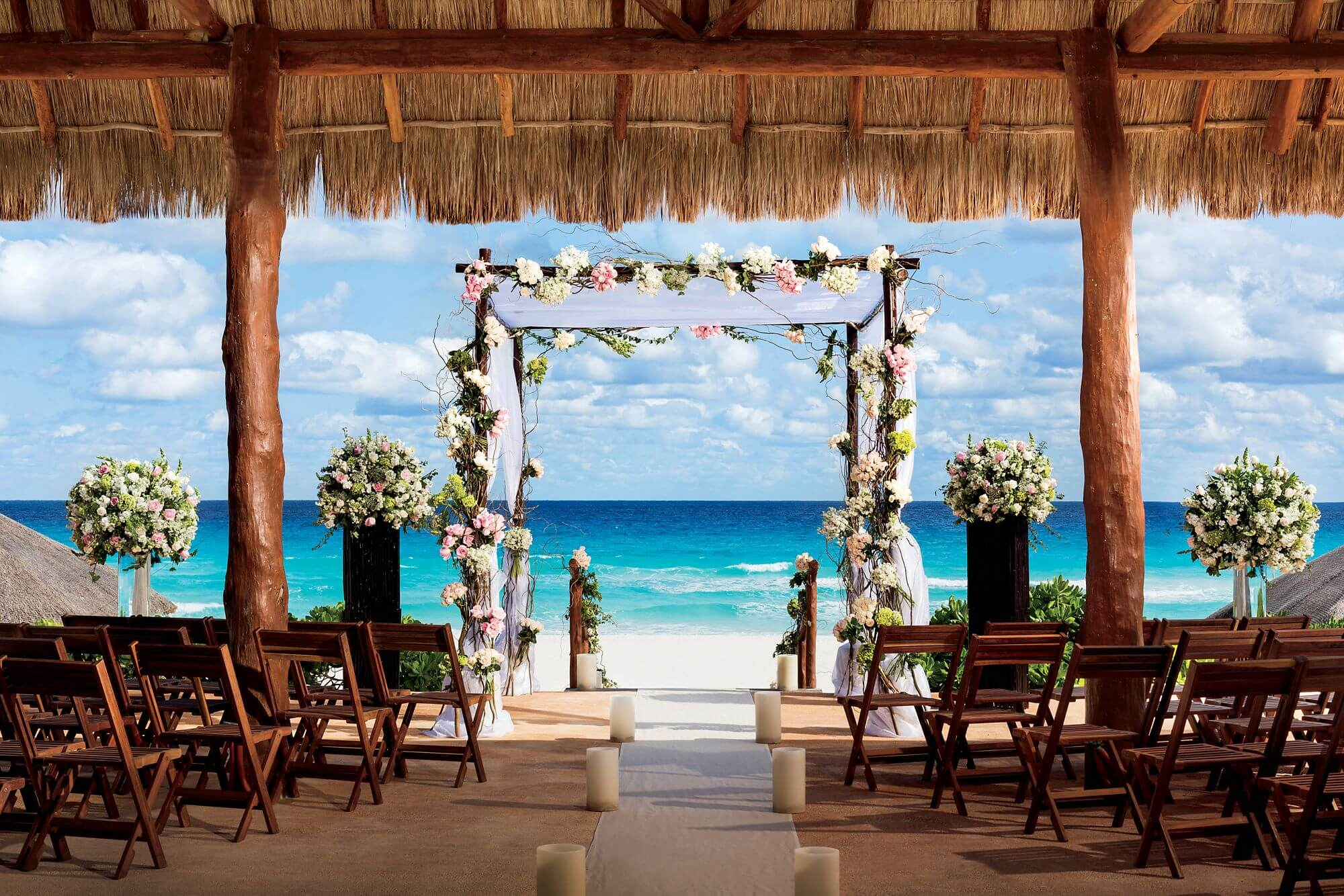beautifully decorated beach wedding arch in Cancun