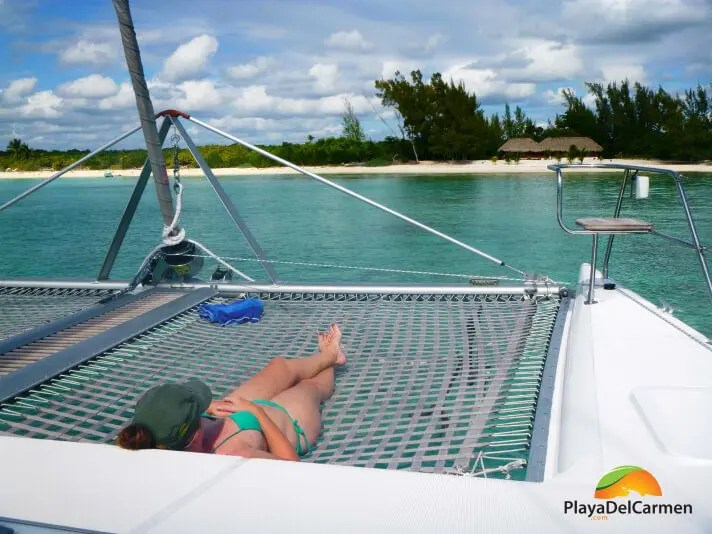 Person relaxing on catamaran