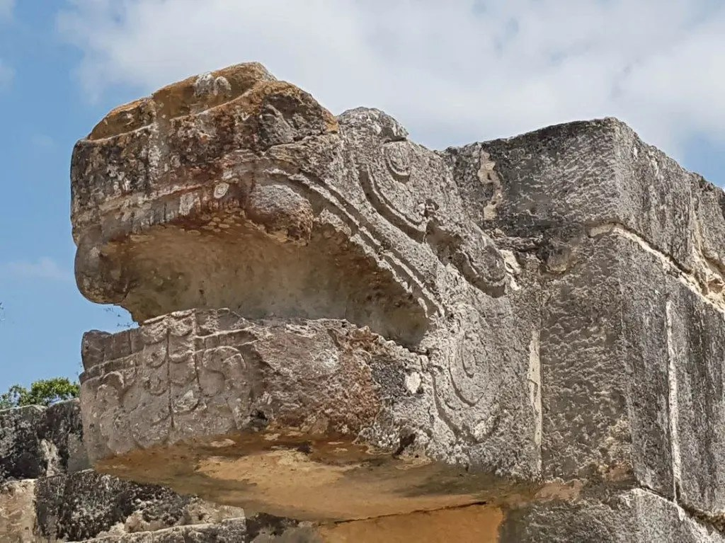 A carved serpent at Chichen Itza ruins in Mexico