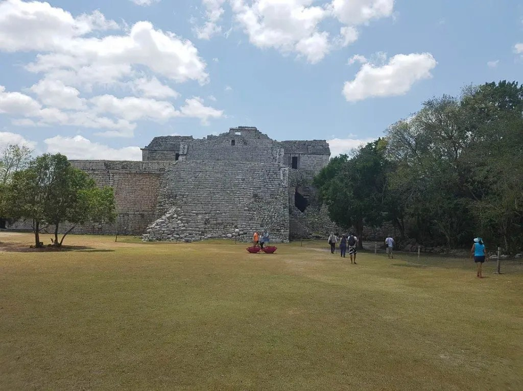 Tourists visit the ruins on a Chichen Itza tour