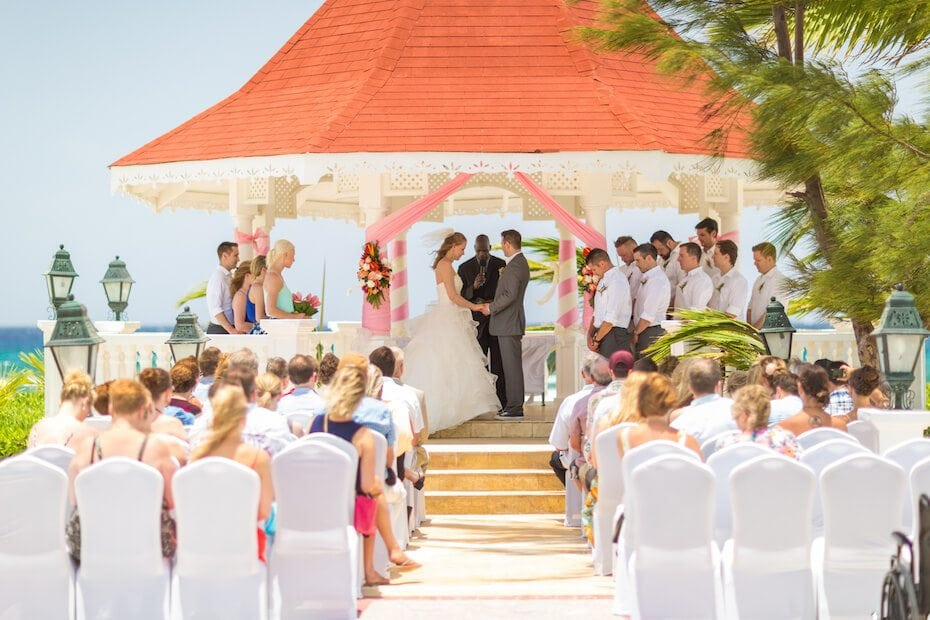 Wedding ceremony taking place under a gazebo in Cancun