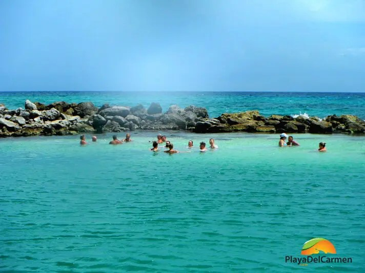 People relaxing in water in playa del carmen