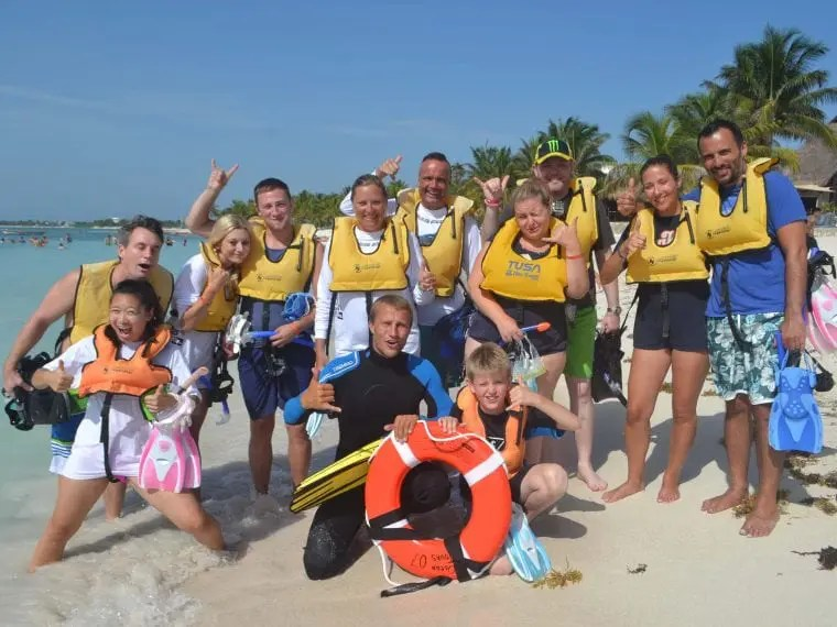 People with life jackets on the beach
