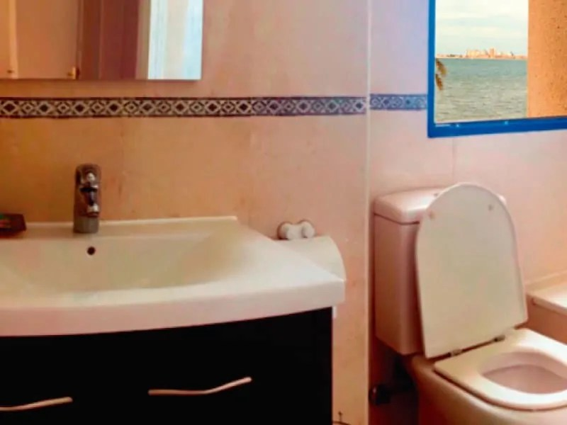 Bathroom with sea facing window
