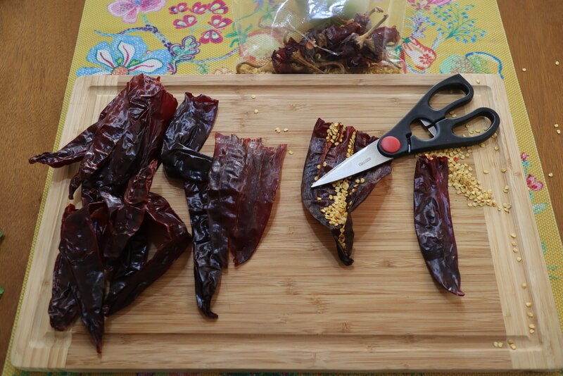 Cleaning chiles to make gluten free enchiladas