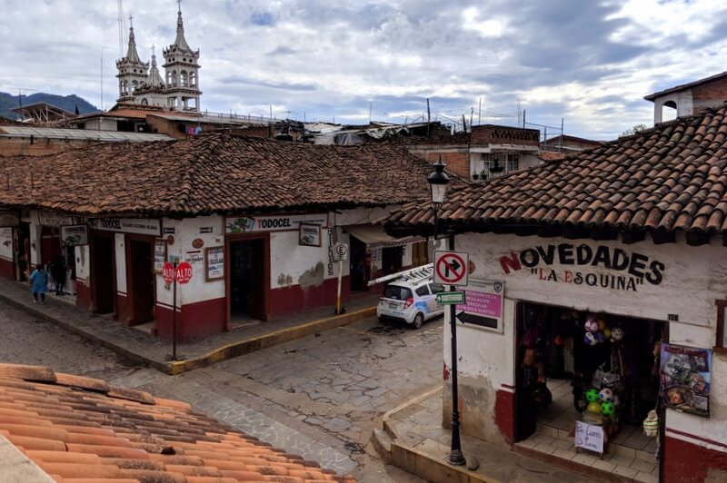 red tile rooves and a church in the background in one of Jalisco's favorite pueblos magicos