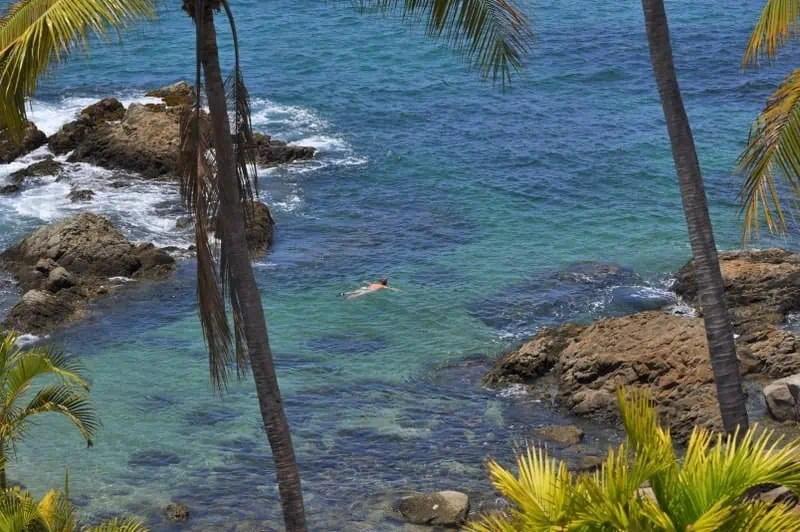 Man swimming in Conchas Chinas Beach in Puerto Vallarta