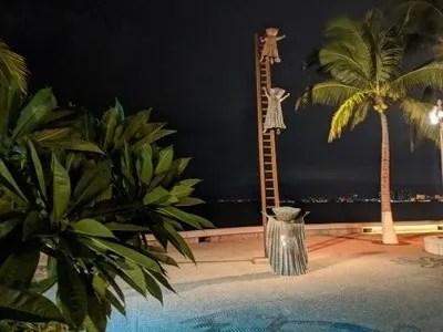 Sergio Bustamante sculptures on the beach boardwalk in Puerto Vallarta