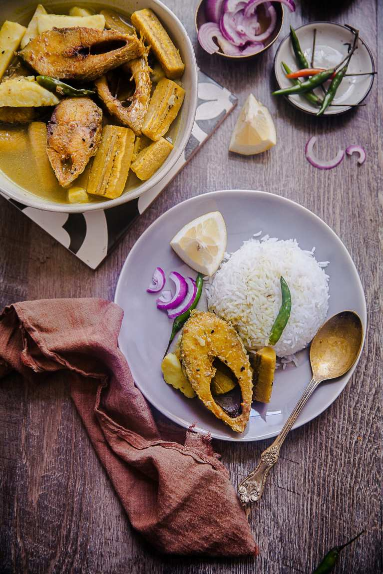 Ilish Maach Kacha Kola Jhol - A Bengali style fish curry with plantain and potato. Very mild and not spicy #bengali #fishcurry #Ilish #maach #indian #plantain #jhol