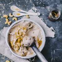 Creamy Tahini Ice Cream in a big bowl with a scoop