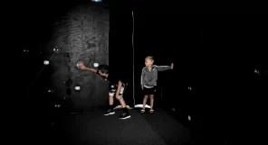 Kids playing in laser maze