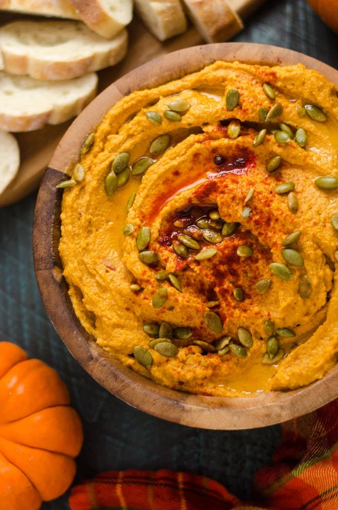 Pumpkin hummus dip along with other fall party food