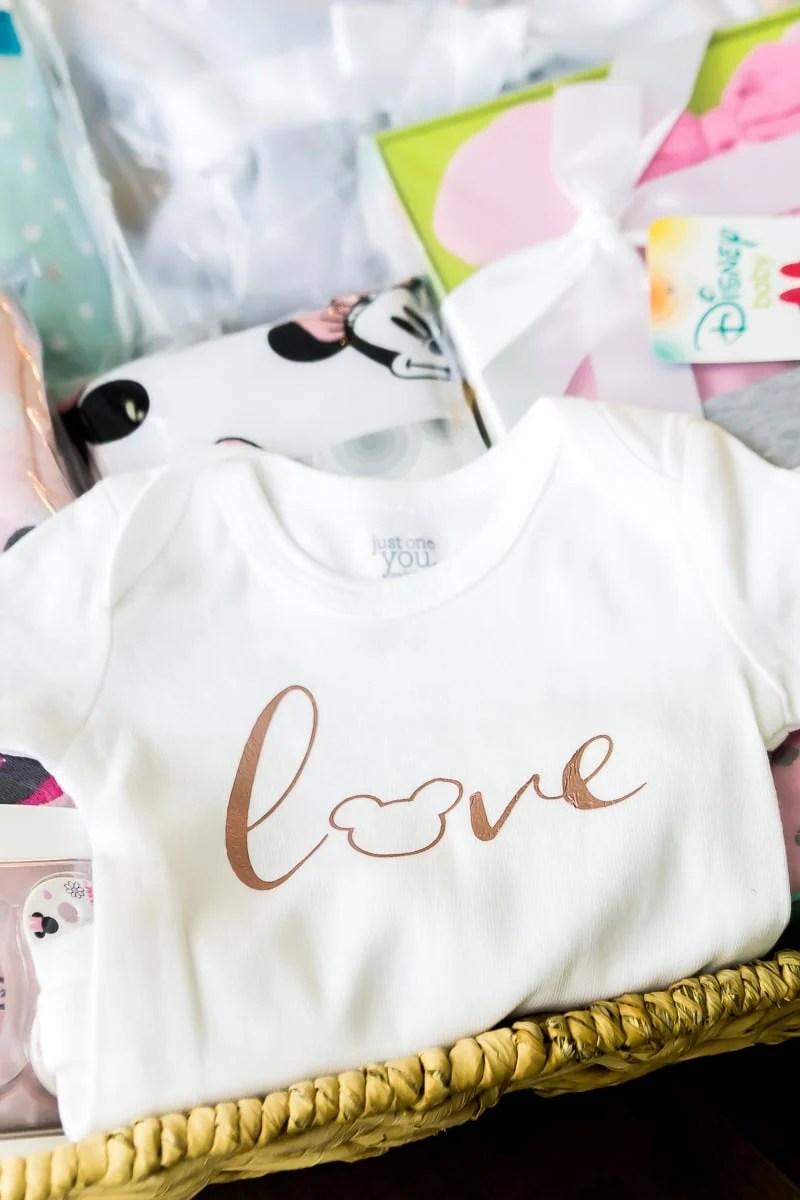 A DIY DIsney onesie and a baby shower gift basket