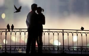 a man hugs woman on the bridge