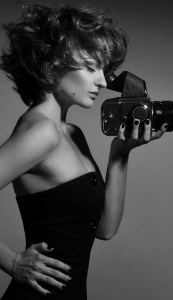 A girl in dress with a camera