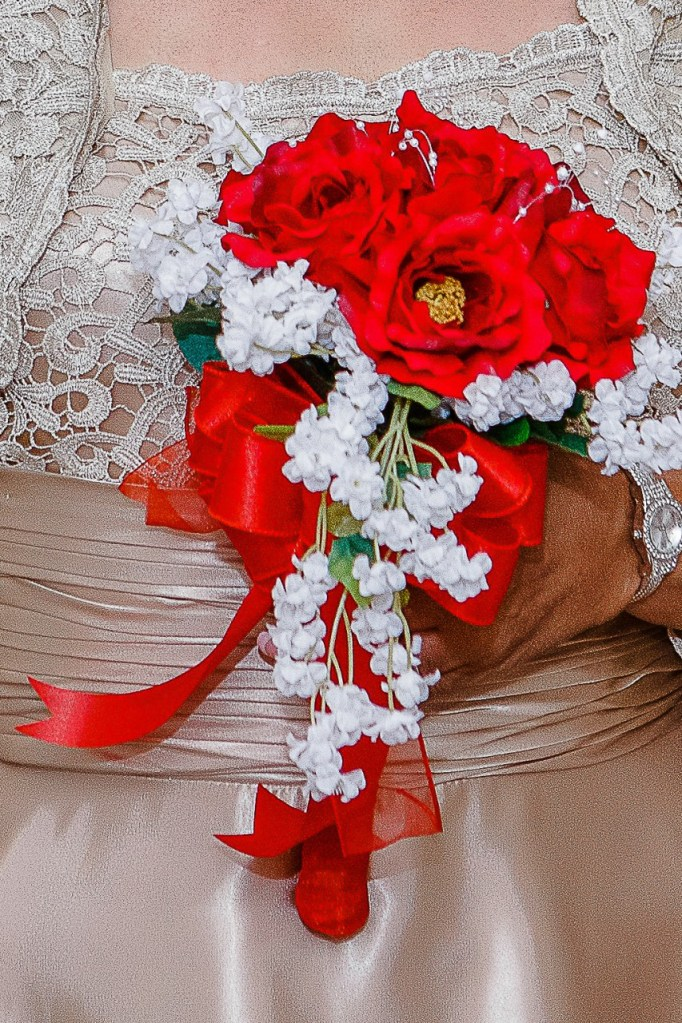 red flowers for wedding with bow