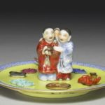 Famille Jaune-rose figural plate
