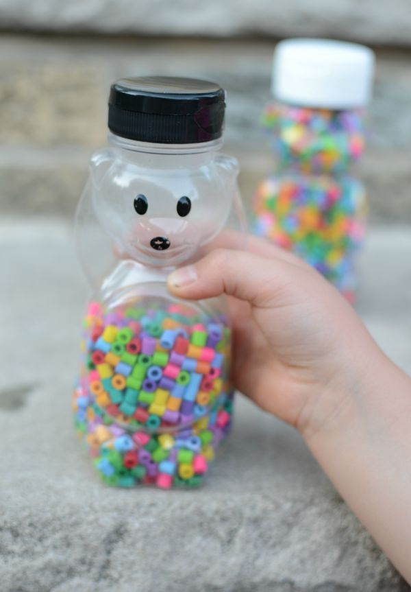 Rainbow sensory bottle for baby and toddler. A sensory bottle AND DIY rattle in one!