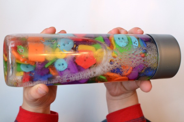 Button Shape sensory bottle! Talk about colors and shapes with your preschooler with this bottle!