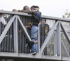FZsmG97RndACSHytgVWprhZ33wL5QuwtAR cAdHbfv8 People holding onto man trying to commit suicide