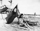 eXGdsW1tPRvu I3unBbFYAG9aUJT ER DHIL0rptd78 Ruth Lee, a hostess at a Chinese restaurant, flies a Chinese flag so she isn't mistaken for Japanese when she sunbathes on her days off in Miami, in the wake of the attack on Pearl Harbor, Dec. 15, 1941 [2998 × 2392]