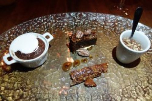 Dessert Sampler (Chocolate souffle with marshmallow whip, Rocky Road Brownie on marshmallow white, carmel sauce and candeid nuts, Chocolate Pot de Creme with chocolate chip crumble)