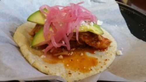 Tinga Taco (poached chicken in chipotle, avocado, pickled onion)