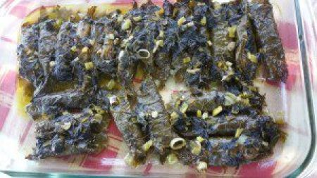 Sardines wrapped in grape leaves