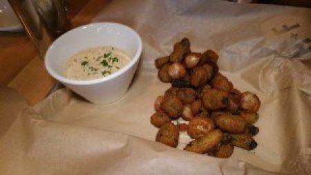 Fried Pickles & Pearls (cornmeal battered cornichon, gherkin & pearl onion, green goddess aioli)