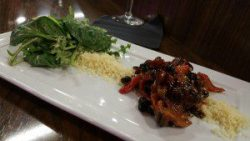 Cous Cous, black beans, mesculin greens, roasted peppers and tomato salad
