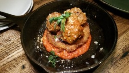 Wagyu Meatballs (beef, pancetta, fried green tomato, fresh herbs romesco)